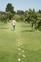 Man walking leaving trail of footprints