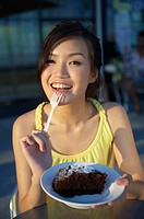 Young Lady Eating Cake