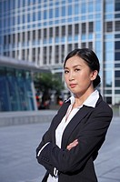 Young Busineswoman Standing in Street