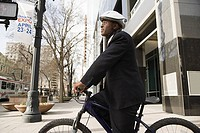 Businessman on bicycle (thumbnail)