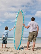 Father and son with surfboard