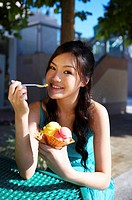 Young Lady Eating Ice_Cream