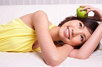 Portrait of Natural Young girl holding Apple, Smiling