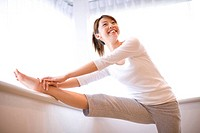 Woman who has gymnastic exercise in morning
