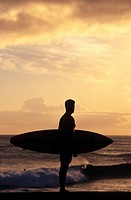 Man on Beach with Surfboard