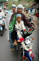 Panjim Goa, India, Muslims on motor-bikes during the Jashn-Eid-Milad Un Nabi feast, to commemorate prophet Mohammed's birth