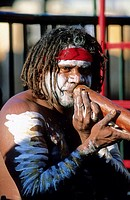 Aboriginal playing didjeridoo (or didgeridoo) musical instrument at Circular Quay. Sydney Warf Pier, Australia