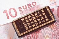 Good luck Chinese hand carved bamboo on a ten euro banknote