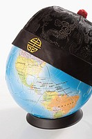 Chinese traditional cap on a globe