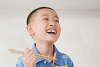 Close_up of a boy eating food and smiling