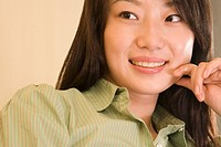 Close_up of a young woman smiling and looking sideways