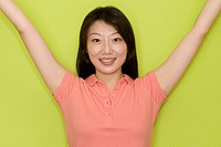 Portrait of a female office worker smiling with her arms raised