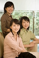 Portrait of three female office workers smiling in an office