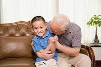 Portrait of a boy smiling with his grandfather