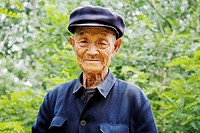 Portrait of a senior man wearing a flat cap, Zhigou, Shandong Province, China