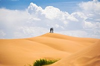 Two people standing on a sand dune, Kubuqi Desert, Inner Mongolia, China