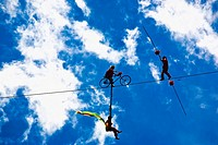 Three performers performing stunt on a rope, Emerald Valley, Huangshan, Anhui Province, China