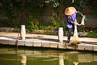 Fisherman holding a fishing net, Guilin, Guangxi Province, China (thumbnail)