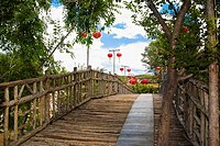 Low angle view of Chinese lanterns hanging along a boardwalk, HohHot, Inner Mongolia, China