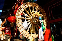 Chinese lanterns and wheel at a market stall, HohHot, Inner Mongolia, China
