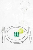 Pills and single leaf of lettuce on drawing of plate