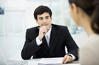 Businessman listening carefully to client