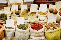 Sacks of herbs and spices at a market stall, Tai´an, Shandong Province, China