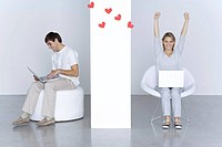 Man and woman using laptop computers, hearts floating between them, woman´s arms raised