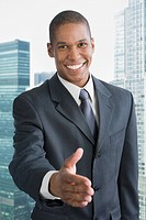Mixed race businessman offering hand to shake