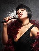 Glamorous woman singing