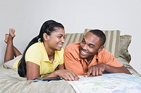 Multi_ethnic couple looking at map
