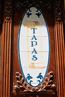 Spain _ Madrid _ Tapas bar _ old _ ceramic tiles in wooden frame _ notice