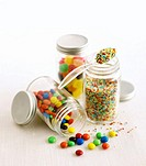 Chocolate beans, sprinkles and sweets in jars