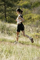 Young woman jogging in countryside
