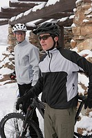 Two male cyclists with mountain bikes in snow