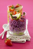 Bean and strawberry salad with honey in glasses