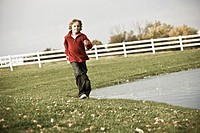 Boy 10_11 running across field