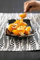 Fried peaches with caramel and flaked almonds