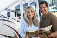 Couple looking through RV brochure portrait