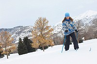 Woman cross_country skiing in snow covered field
