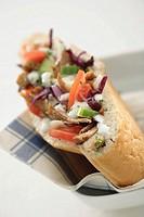 Döner kebab with paper napkin