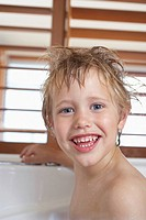 Boy with messy wet hair in Bathtub close_up