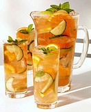 Pimm´s Summer Punch in carafe and three glasses