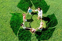 Teacher and students playing on recycling symbol