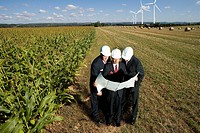 Businessmen inspecting wind power plant (thumbnail)
