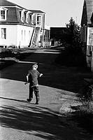 Rear view of a boy walking in the street
