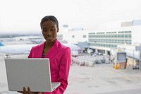 Close_up of a businesswoman using a laptop at an airport