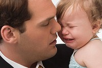 Close_up of a young man consoling his daughter