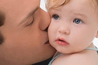 Close_up of a young man kissing his daughter