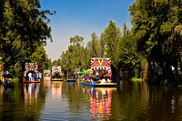 Tourists on trajineras boats in a canal, Xochimilco Gardens, Mexico City, Mexico (thumbnail)